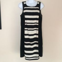 NWT Kensie Black & White Chevron Dress A black and white patterned chevron dress with black siding. Faux leather details around the shoulder/arm pit. Black studs along the neck collar. This is a re-posh. Didn't fit me, but it's such a fun dress that needs a great home! Kensie Dresses Midi
