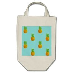 Pineapple Pattern on Blue Canvas Bags. A repetitive pattern of simple pineapples on a bright blue background. This is a cute and summery pattern perfect for many occasions.