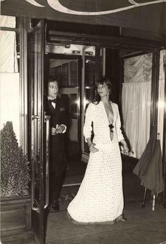 Jane Birkin and Serge Gainsbourg leaving Maxim's in Paris, 1969, by Daniel Angeli