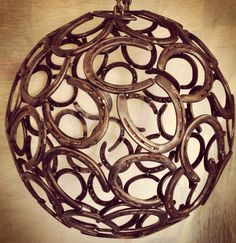 "Custom ""horseshoe chandelier"" made from reclaimed shoes. Size of the chandelier is 22.5"" in diameter. $200 without lights, $250 with lights. The lighting is not pictured but will include several Edison bulbs clustered in the center of the sphere. If you are interested in this piece or have an idea and would like to see it come to life please contact Welded with Faith @ 918.462.7308."
