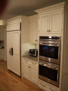 White cabinets beadboard kitchen cabinets painted for Built in oven kitchen cabinets