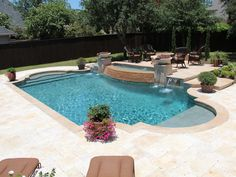 Here is another angle of the pool in images 126, 127 & 128. This angle shows the classical Roman form this pool has and how symmetrical the pool is as a whole. This angle also shows another view of the elevated seating area around the fire pit located behind the water features. The patio surface…