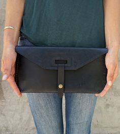 Strap Closure Leather Clutch by Reagan & Rose