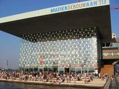 Muziekgebouw aan 't IJ, a modern concert hall in Amsterdam near the water with a broad range of genres. But classical music makes the largest part (piet heinkade 1) http://www.muziekgebouw.nl/