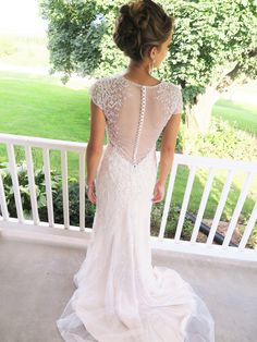 Dramatic illusion back with buttons. LOVE!