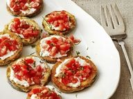 Eggplant Ricotta Bites :: Lightly breaded eggplant is sauteed instead of deep-fried, giving it crunch without excess oil. Its then topped with ricotta and tomatoes for an eggplant Parmesan-inspired appetizer with much less fat.    sounds SO yummy!