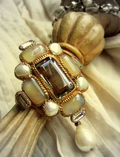 Hand-made costume jewelry in Byzantine - Medieval style. Center stone is smoky quartz, surrounded with fused glass, fresh water pearls and Czech crystal glass stone.