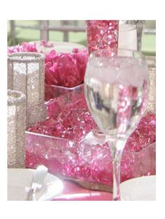 At the Base of these Beautiful Huge Crystal filled vases you will see glamourous Silver Glitter Votives, Pink Rock Candies and Pink Flower Vases.