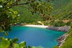 Kaminia is a beach in southeastern Ithaca, ideal for relaxation and spending a day on the beach, under the hot summer sun. Ithaca Greece, Pebble Beach, Greek Islands, Greece Travel, Luxury Villa, Beautiful Islands, Summer Sun, River, Villas