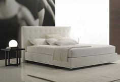 I still love this bed - we can find a white / cream faux leather
