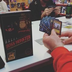 We are play testing Boss Monster this afternoon a card game based on the NES game for up to four players. Heroes dungeons and big bad bosses and monsters. Sounds tricky but we are getting the hang of it!