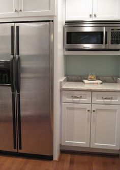 Fridge-depth cabinet with microwave recessed