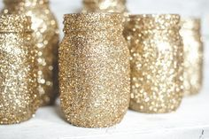 Craft gold glitter mason jars for your child's Shimmer and Shine birthday party! They would make great lanterns, vases, or regular centerpieces for your party spread. And, they resemble genie bottles!