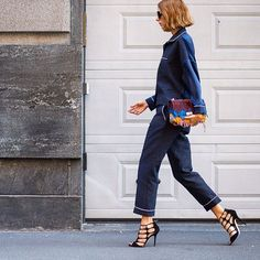 Pajama-inspired coordination continues to be a hit at #MFW. Ensure the look is more luxe than lounge by pairing with statement stilettos. #streetstyle by theurbanspotter