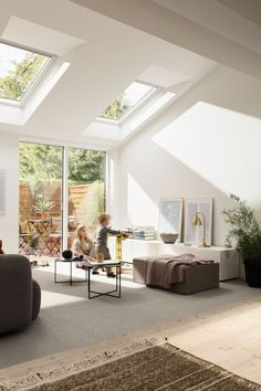 Bright Scandinavian living room with roof windows and increased natural light. This is the kind of home extension I would love to add to our home. Love the garden view too.