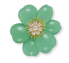 """A DIAMOND, CHRYSOPRASE AND GOLD """"ROSE DE NOEL"""" BROOCH, BY VAN CLEEF & ARPELS  Centering upon a circular-cut diamond pistil with 18k gold stamen, extending chrysoprase chalcedony sculpted petals, mounted in 18k gold, 2004, with French assay marks and maker's mark"""