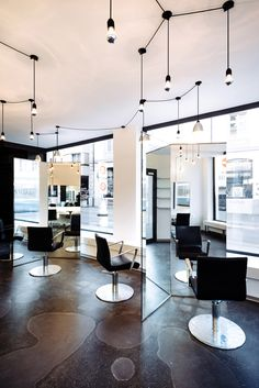 Sculptural mirrors frame spaces in Zurich barbershop by Wülser Bechtel Architekten