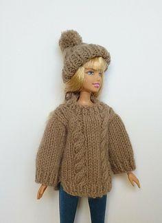 Ravelry: Barbie's Aran pattern by linda Mary Barbie Knitting Patterns, Knitted Doll Patterns, Knitting Dolls Clothes, Knitting Paterns, Barbie Clothes Patterns, Crochet Barbie Clothes, Doll Clothes Barbie, Knitted Dolls, Free Knitting