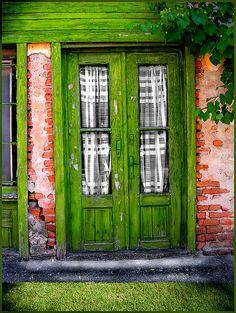 I like the ruff brick wall with the green door