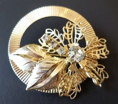 Vintage Textured Gold Tone and Filigree Figural Floral Brooch. by Bestintreasures on Etsy