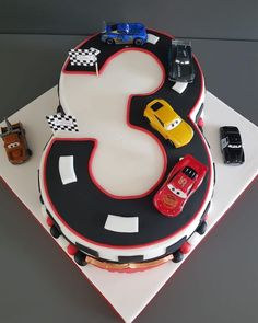 A huge celebration cake with custom made number three race track, topped with Cars character models. Toys after cake, can they get much happier?  Book their birthday cake in Shoreham-by-Sea, Brighton and surrounding areas... Cars Characters, Number Cakes, Kids Hands, Character Modeling, Celebration Cakes, Brighton, Race Cars, Track, Birthday Cake