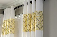 put a panel of fabric into white curtains for a pop of color