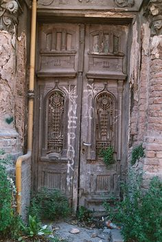 Sarajevo, old wooden door, carved, beauty, entrance, portal, doorway, graffitti, tags, details,