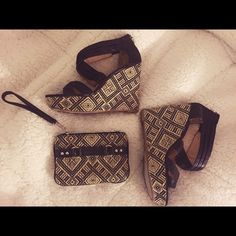 Printed Wedge and Wristlet Set! These super high, printed wedges are sure to make an impact! Size 9, worn once. Excellent condition. With the matching wristlet these items are sure to make any little black dress pop! Shoes