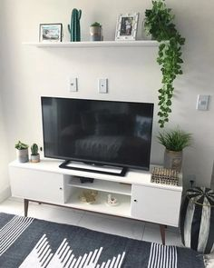 home decor minimalist 32 Nice Modern Minimalist Wall Decor Ideas For Your Interior - Contemporary home decor is the top of the line when it comes to home decor styles to bring to play in your home. While most people have a general idea. Deco Tv, Deco Studio, Tv Wall Decor, Wall Decor Above Tv, Shelf Above Tv, Living Room Decor Inspiration, Tv Wall Design, Living Room Tv, Living Room Decor Above Tv