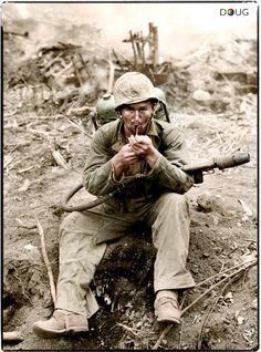 A US Marine with a M2-2 Flamethrower at Iwo Jima. February 1945. Before they knew smoking can kill you just as much as bullets