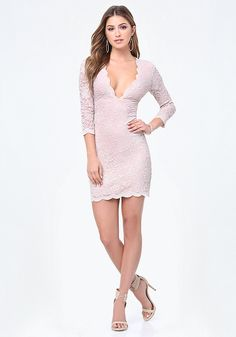 Super-seductive lace dress finished with scalloped edges and a high-impact plunge neck. 3/4 sleeves. Hidden back hook-and-eye and zip closure. Partially lined.