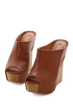 3adda72c731ae9 Show off your charismatic style by stepping into these deep-brown wedges!