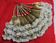 Beautiful handmade beaded long tassels can be used for various craft work,embellishing saree blouse,skirts,dresses etc. The overall length of the tassel is 9 inches (including the hang). The hang is about inches - that makes the tassel at inches. Saree Tassels Designs, Saree Kuchu Designs, Embroidery Fashion, Crafts For Girls, Textiles, Artisanal, Saree Blouse, Dress Patterns, Handmade