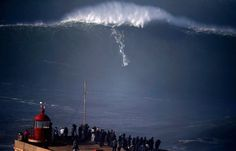 Reuters photographer captures big wave frenzy in Nazare Portugal. Amazing!