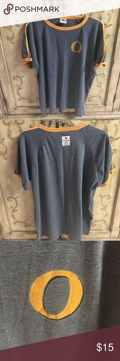 """Bacardi T-Shirt This one has been well loved but has plenty of life left! Such a soft and comfy tee. Heather gray with orange trim around arms, sleeves and neck. Big orange """"O"""" on front and Bacardi logo on back. Only wear is around neck trim but it's such an awesome shirt it doesn't matter!! Just adds more character to it! Bacardi Tops Tees - Short Sleeve"""