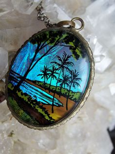 """Blue Morpho Butterfly Wing Necklace, Tropical Beach Scene, Luminous Sky and Water, Glass Cover, Silver Plated Mount, 16"""" Sterling Chain by postGingerbread on Etsy"""