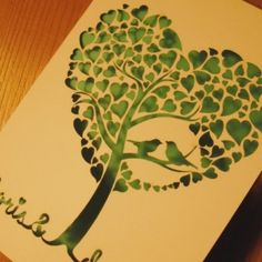 This would be a beautiful tattoo two love birds in a tree of life with hearts