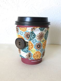 Fabric Coffee Cozy Teal Brown and Orange Daisies by ThreadBasket, $7.50