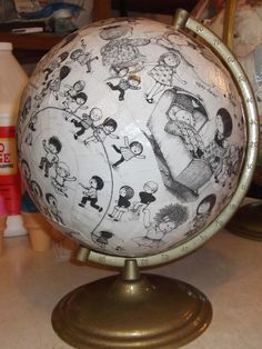 "Love the way they used a favorite children's book to modge podge this globe. It would be realllly cool if it was a ""Where's Waldo"" globe or ""find it"" book."
