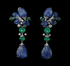"""""""L'Odyssée de Cartier Parcours d'un Style """" Collection -  Indian Influences – High Jewelry Earrings Platinum, two pear-shaped carved sapphires totaling 25.24 carats, melon-cut emerald beads, cabochon-cut emeralds, sapphire carved leaves, brilliants."""