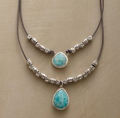 """ECHO LAKE NECKLACE--Two amazonites echo each other amidst handcrafted Thai silver beads on a knotted leather necklace handmade exclusively for Sundance. Thai silver hook and clasp. 18""""L."""