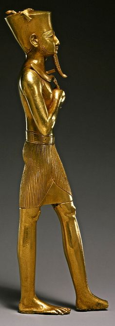 Golden statuette of Amun. He is identified by his characteristic flat-topped crown, which originally supported two tall gold feathers, now missing. Third Intermediate Period, Dynasty 22, ca. 945–715 b.c. Egyptian, Met Museum