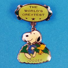 Snoopy is giving out three of his most prestigious awards. Find these vintage Peanuts pins and more in our shop at CollectPeanuts.com.