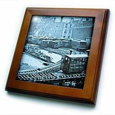 """1860s New York City Train on Elevated Railroad Yonkers Switch Station Cyan - 8x8 Framed Tile by 3dRose. $22.99. Solid wood frame. Cherry Finish. Inset high gloss 6"""" x 6"""" ceramic tile.. Dimensions: 8"""" H x 8"""" W x 1/2"""" D. Keyhole in the back of frame allows for easy hanging.. 1860s New York City Train on Elevated Railroad Yonkers Switch Station Cyan Framed Tile is 8"""" x 8"""" with a 6"""" x 6"""" high gloss inset ceramic tile, surrounded by a solid wood frame with pre-drilled keyhole for..."""