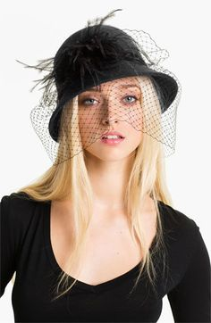 'Angelica' Cloche.  I just love a good hat.  And what is more glamorous than a veil?  I'd feel very film noir in this.