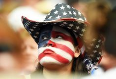 A fan waits for the start of the Group D match of the FIFA Women's World Cup between the USA and Australia at the Winnipeg Stadium