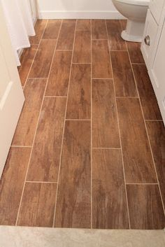 Wood Grain Porcelain Tile - great look and water resistant. for the upstairs bathroom?