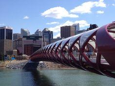 Calgary Peace Bridge with view of downtown Calgary.