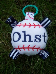 GOOOOO  YANKEES   BaseBall Baby Toy    Are these by deborahbabarskas, $8.00    This can be made as a baby toy or a toy for your pet -- with or without ribbons.   For the babies I usually put in a krinkle sound and for the pets I put in a squeeker  -- can be for baby too. www.Etsy.com/shop/deborahbabarskas