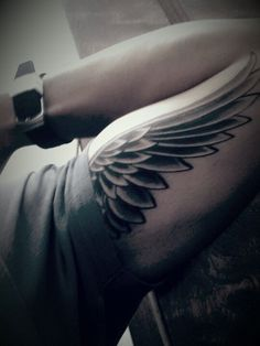 Wing tattoo for coverup on my right shoulder & tricep: